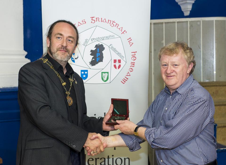 IPF President Michael O'Sullivan presenting Bob Morrison with Brendan Walkin Award for his service to Irish Photography