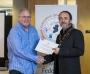IPF President Michael O'Sullivan presenting first place colour print panel to Creative Photo Imaging Club.jpg