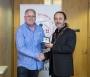 IPF President Michael O'Sullivan presenting individual monochrome bronze medal to Ross McKelvey.jpg