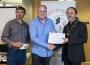 IPF President Michael O'Sullivan presenting second place monocrhome panel to Creative Photo Imaging Club.jpg