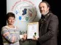 IPF President Michael O'Sullivan pictured presenting LIPF distinction to Karen Maguire