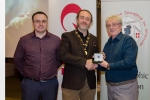 Shane Cowley from Canon Ireland and judge Rikki O'Neill presenting his judge's award medal to Michael O'Sullivan