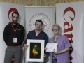 Philip Desmond from Canon Ireland and IPF Vice-President Lilian Webb pictured with award winner Vladimir Morozov .jpg