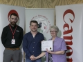 Philip Desmond from Canon Ireland and IPF Vice-President Lilian Webb pictured with award winner Vladimir Morozov.jpg
