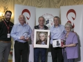 Philip Desmond from Canon Ireland, judges Sandy Cleland, Leo Palmer and Peter Gennard along with IPF Vice-President Lilian Webb pictured with overall winning image and some of the prizes its author receives.jpg