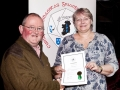 Mark Sedgwick presenting Yvonne Acheson, LIPF, with her certificate & badge at AV2015.