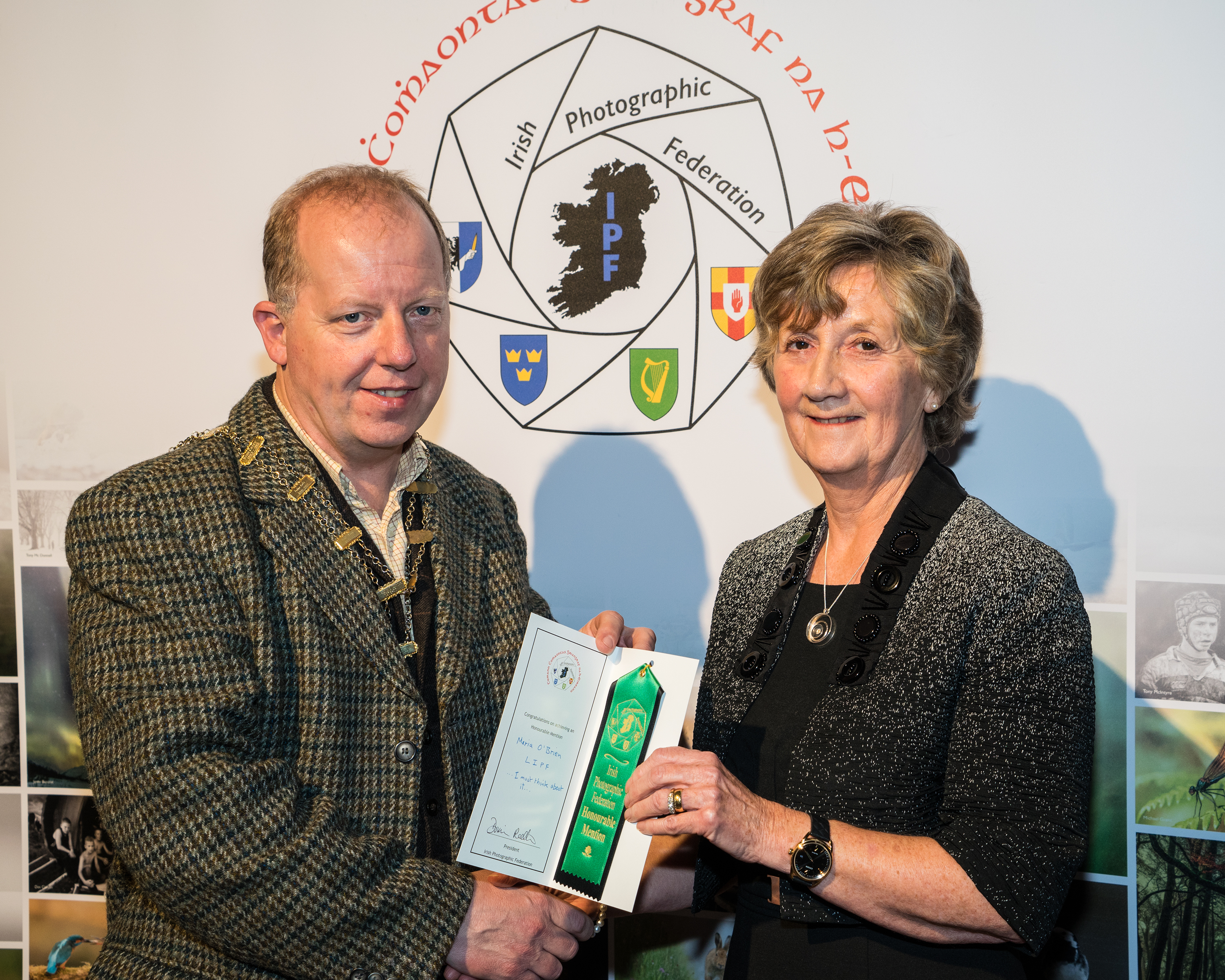 Dominic Reddin, FIPF presenting Maria O'Brien, LIPF with an Honourable Mention Certificate