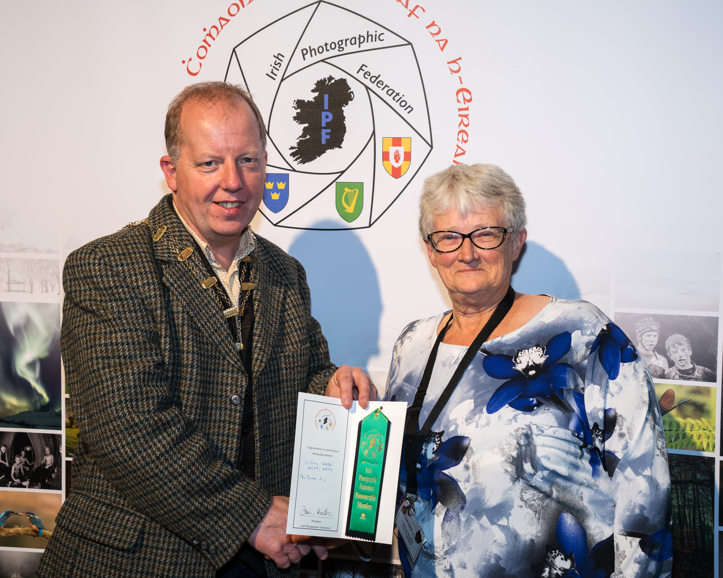 Dominic Reddin, FIPF presenting an Honourable Mention Certificate to Lilian Webb, AIPF ARPS