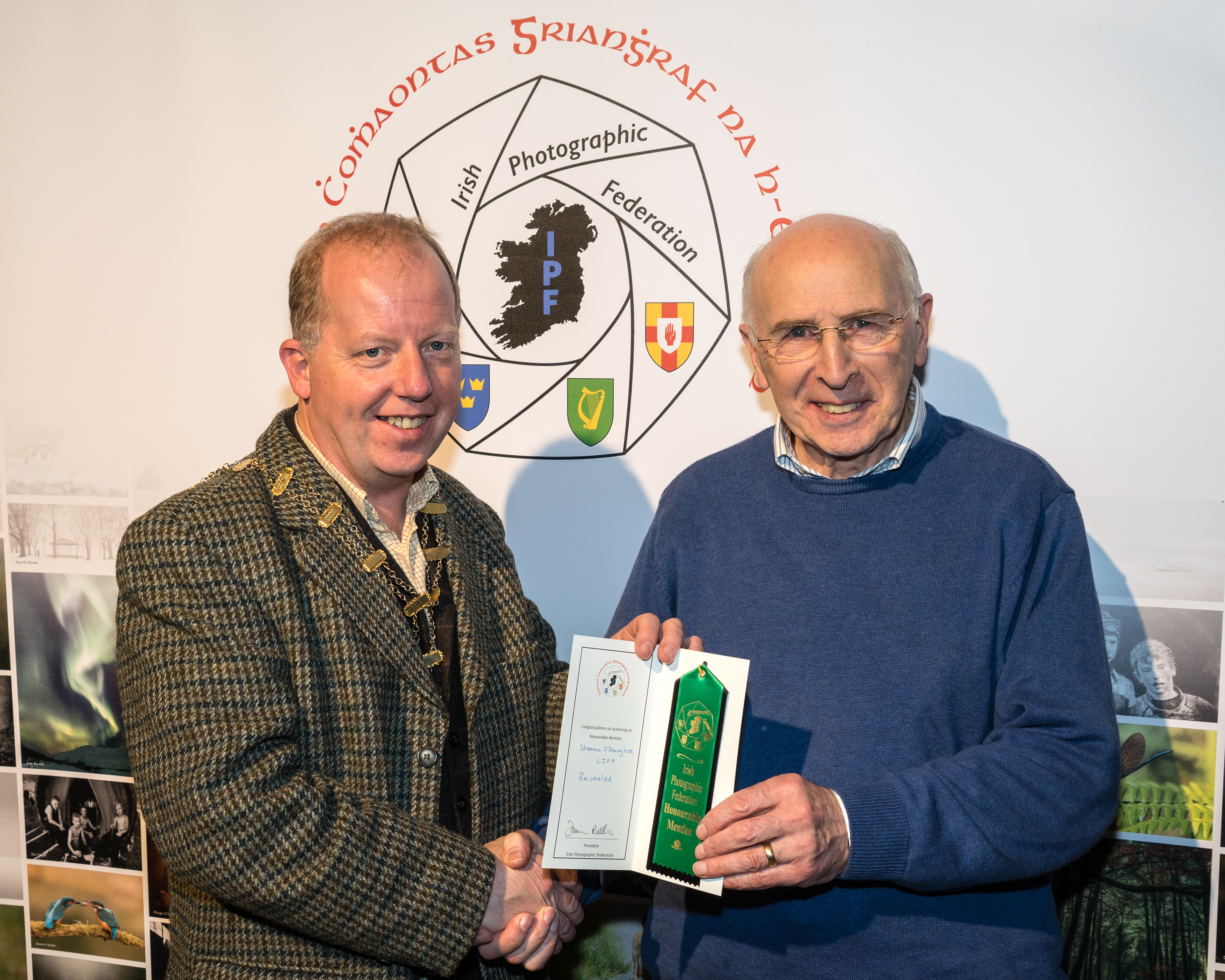Dominic Reddin, FIPF presenting an Honourable Mention Certificate to Sheamus O'Donoghue, LIPF