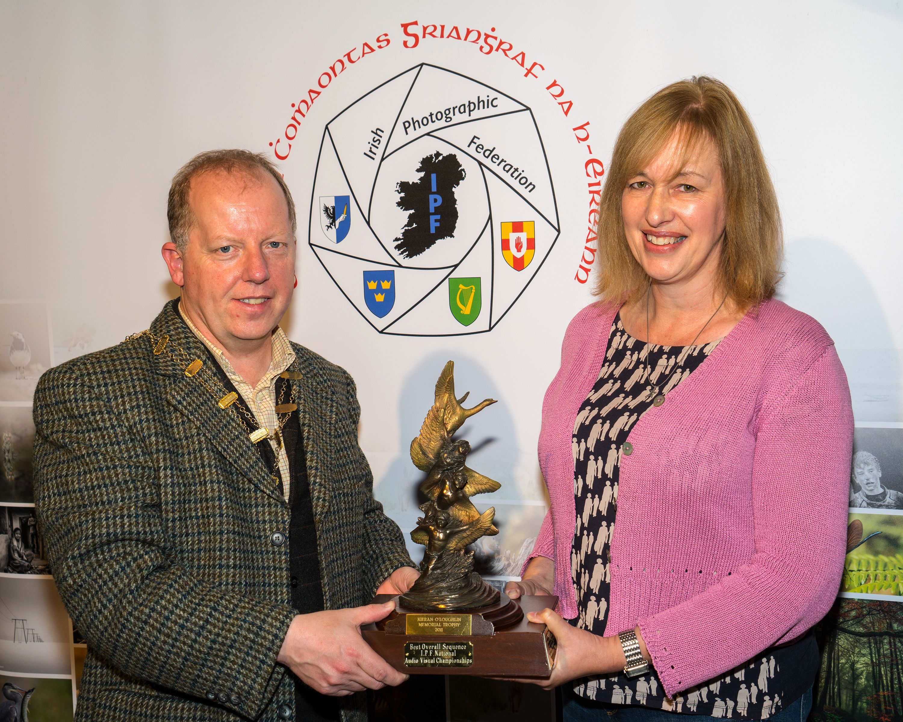 Dominic Reddin, FIPF presenting the Kieran O'Loughlin Memorial Trophy to Judith Kimber, LIPF DPAGB-AV