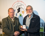Dominic Reddin, FIPF presenting the Bronze Medal to Malcolm Imhoff for Richard Brown