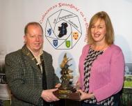Dominic Reddin, FIPF presenting the Kieran O'Loughlin Memorial Trophy to Judith Kimber, LIPF DPAGB-AV