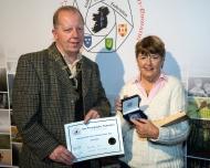 Dominic Reddin, FIPF presenting the Silver Medal to Rita Nolan LIPF