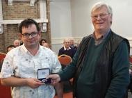 Martin Tobin receiving his Silver Medal from Edwin Bailey, LIPF