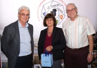 Brendan O'Sullivan, chairman, IPF AV Group Committee, presenting Bev & Alan Tyrer with a memento as judges of the 36th IPF AV Nationals & 1st Photo Harmony competition, 21st October, 2018.