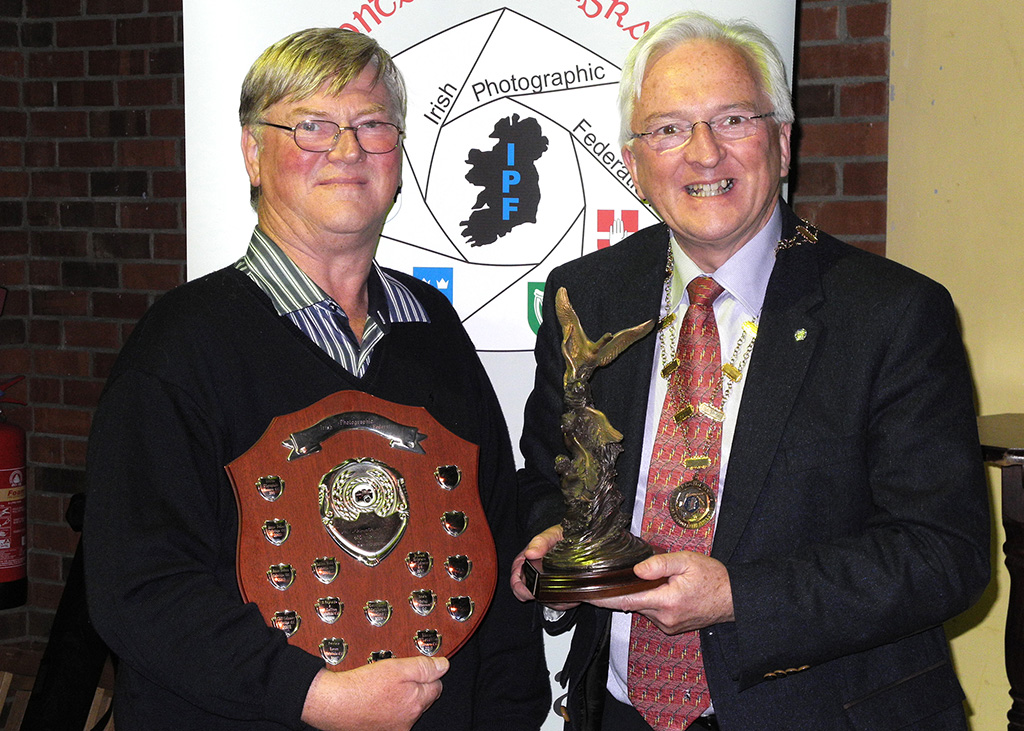 Edwin Bailey, gold medal winner in advanced category, winner of best photography award and winner of best overall sequence pictured here receivng Kieran O'Loughlin trophy from IPF President John Cuddihy