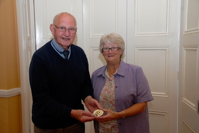 John Wilkinson, AIPF, receiving the Brendan Walkin medal from Lilian Webb, AIPF