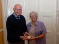 John Wilkinson, AIPF, receiving the Brendan Walkin medal from Lilian Webb, AIPF