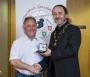 IPF President Michael O'Sullivan presenting individual monochrome gold medal to Frank Condra.jpg