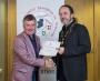 IPF President Michael O'Sullivan presenting third place colour panel to Dundalk Photographic Society.jpg