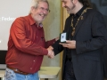 IPF President Michael O'Sullivanpresenting judge Jacky Martin with medal.jpg