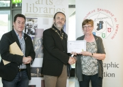 IPF President Michael O'Sullivan presenting 3rd Place Monochrome Club Award to Malahide Camera Club accepted by Catherine Bushe and Joe Doyle