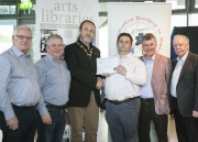 IPF President Michael O'Sullivan presenting 3rd Place Overall Club Award to members of Dundalk Photographic Society