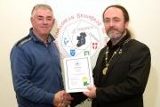 IPF President Michael O'Sullivan presenting Thomas Quiltywith his LIPF distinction
