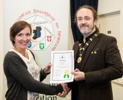 IPF President Michael O'Sullivan pictured presenting LIPF distinction to Iga Sasiela