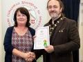 IPF President Michael O'Sullivan pictured presenting LIPF distinction to Helen McQuillan