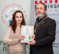 IPF President Michael O'Sullivan presenting licentiateship distinction to Emmanuelle Galisson
