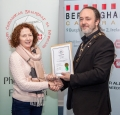 IPF President Michael O'Sullivan presenting licentiateship distinction to Mary A. Hickey