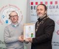 IPF President Michael O'Sullivan presenting licentiateship distinction to Daniel Healy