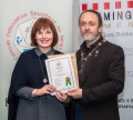 IPF President Michael O'Sullivan presenting licentiateship distinction to Noreen Finn