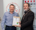 IPF President Michael O'Sullivan presenting licentiateship distinction to Anthony O'Connor