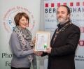 IPF President Michael O'Sullivan presenting licentiateship distinction to Katy Swarbrigg