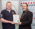IPF President Michael O'Sullivan presenting licentiateship distinction to Darragh Collins