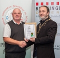 IPF President Michael O'Sullivan presenting licentiateship distinction to Pakie O'Donoghue