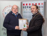 IPF President Michael O'Sullivan presenting licentiateship distinction to Denis Barry
