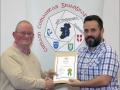 IPF Distinctions Chairman pictured presenting LIPF distinction to Dave Schmidt