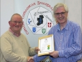 IPF Distinctions Chairman pictured presenting LIPF distinction to Jim Kelly