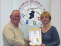 IPF Distinctions Chairman pictured presenting LIPF distinction to Julie Watson