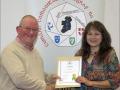 IPF Distinctions Chairman pictured presenting LIPF distinction to Lorraine Strang