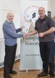 IPF Vice President Sheamus O'Donoghue presenting licentiateship distinction to Neil O'Reilly
