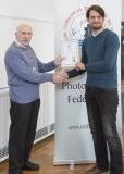 IPF Vice President Sheamus O'Donoghue presenting licentiateship distinction to Zane Llewellyn