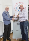 IPF Vice President Sheamus O'Donoghue presenting fellowship distinction to Gerry Kerr