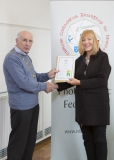 IPF Vice President Sheamus O'Donoghue presenting licentiateship distinction to Catherine Thompson