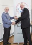 IPF Vice President Sheamus O'Donoghue presenting licentiateship distinction to John Meyler