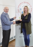 IPF Vice President Sheamus O'Donoghue presenting licentiateship distinction to Kasia Wasiak