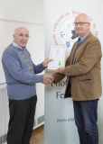 IPF Vice President Sheamus O'Donoghue presenting licentiateship distinction to Mark Overell